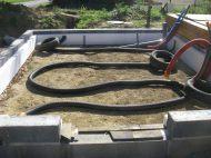 Le drain en place et le polystyrène côté intérieur des murs